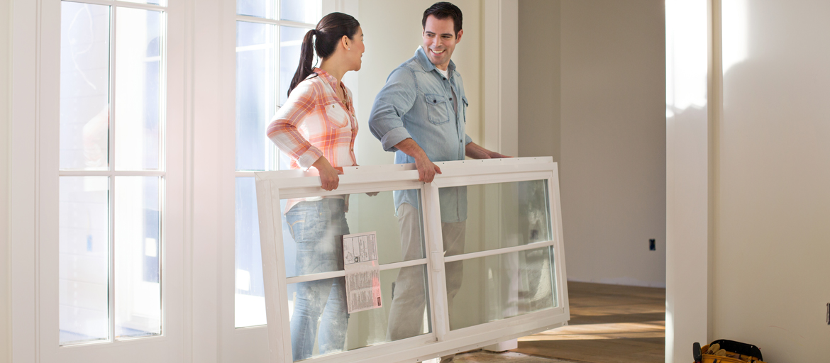 Image depicts couple making home repairs.