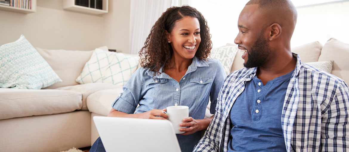 Couple looking fondly at each other as they look over interest rates.