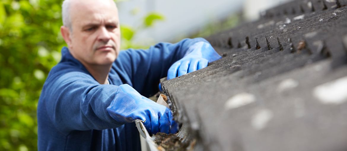 Image depicts man tackling spring maintenance projects.
